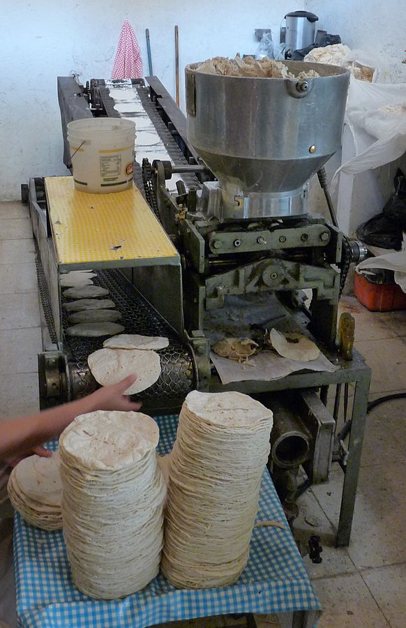 Tortilleria. Tortilla Machine